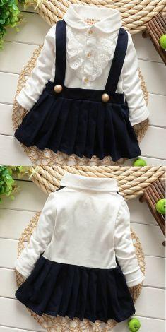 Rochita cu bretele si fusta bleumarin plisata