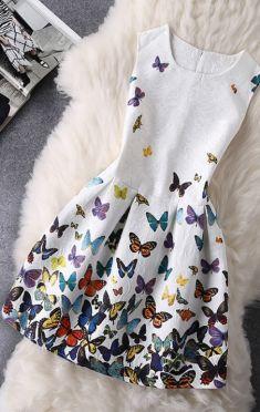 Rochita alba cu fluturi pe fusta